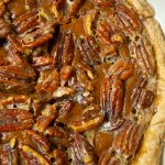 closeup pumpkin pie with pecans