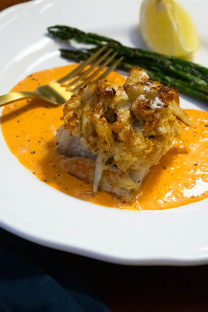 crab topped cod with roasted red pepper cream sauce