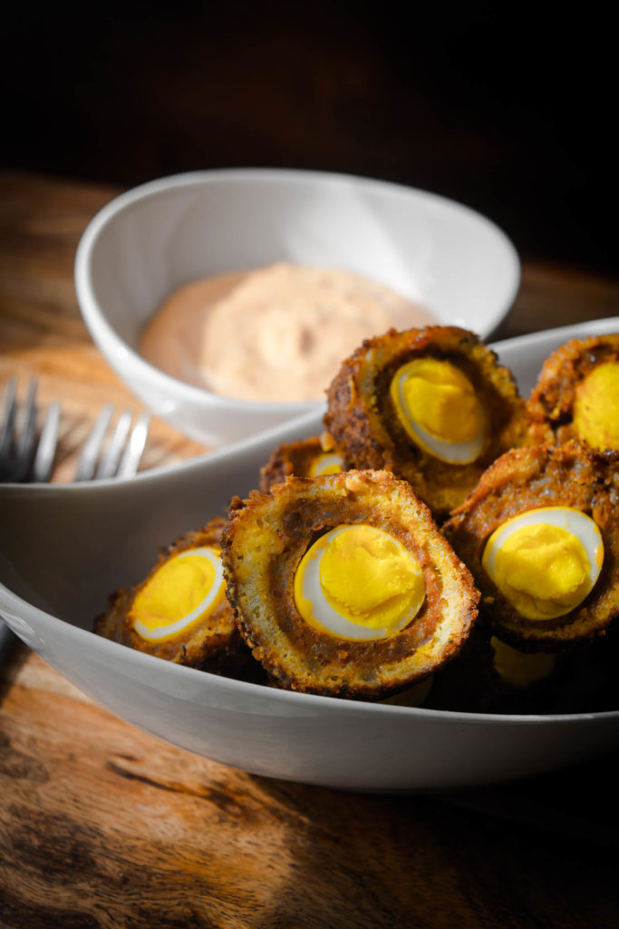 Scotch Quail Eggs with Harissa Cream Sauce