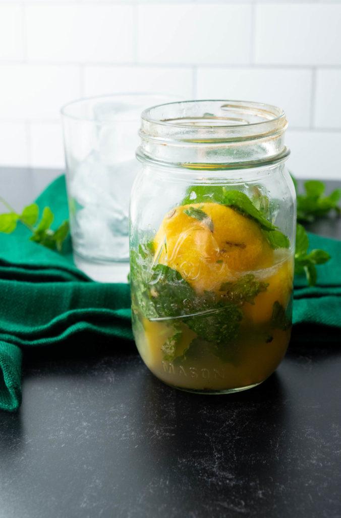 making gin lemon honey cocktail