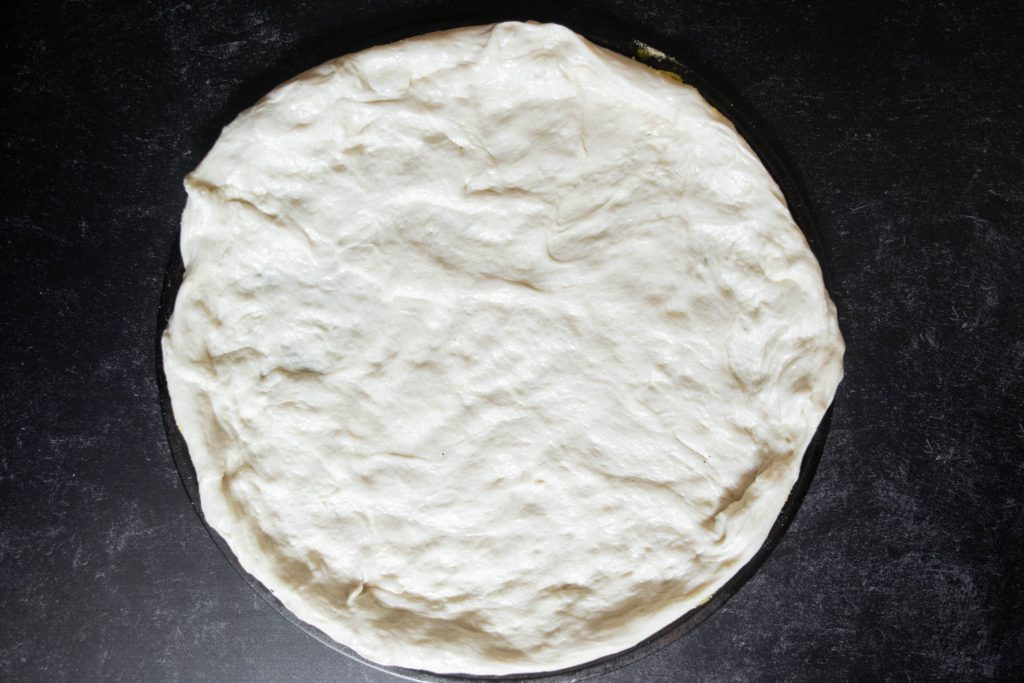pizza dough on pan