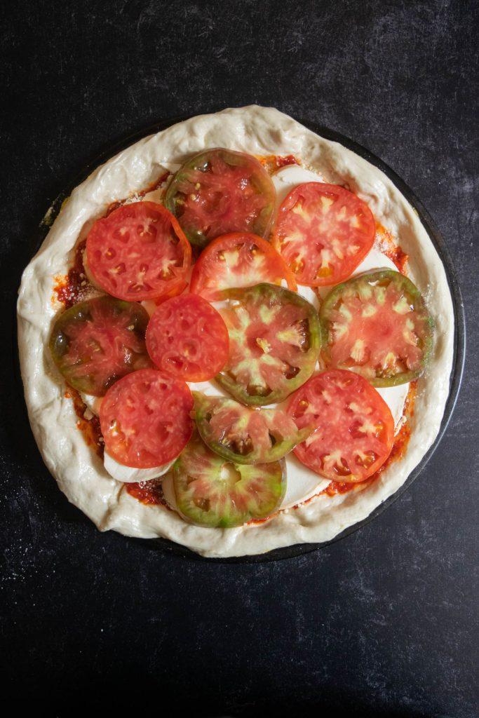 heriloom tomato layer on pizza