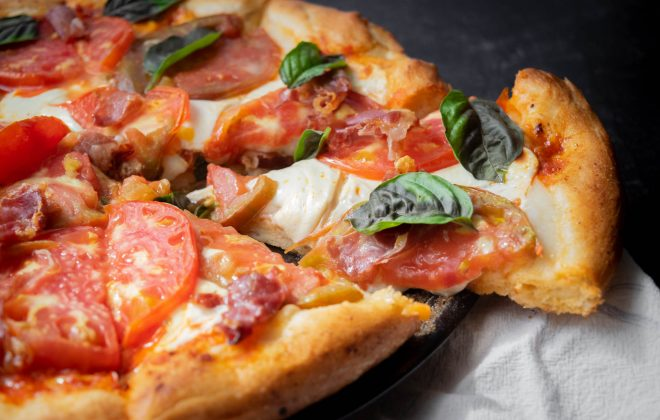 Harissa Pizza with Smoked Mozzarella, Heirloom Tomatoes and Prosciutto