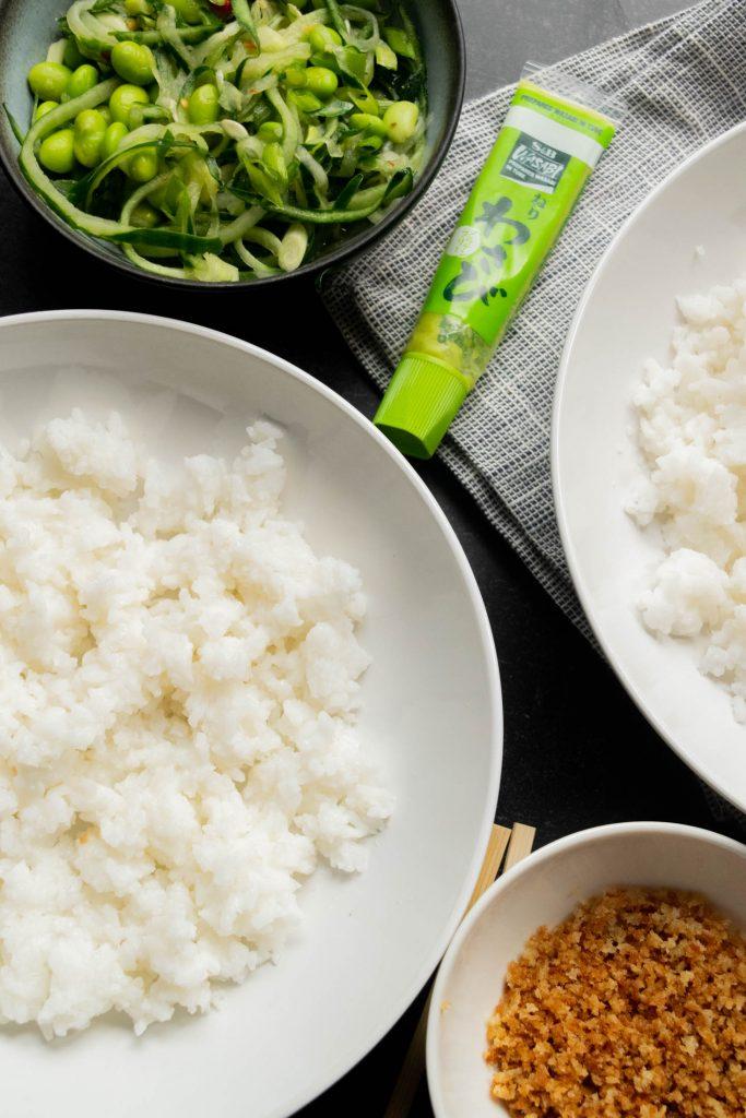 assembling sushi bowls with wasabi