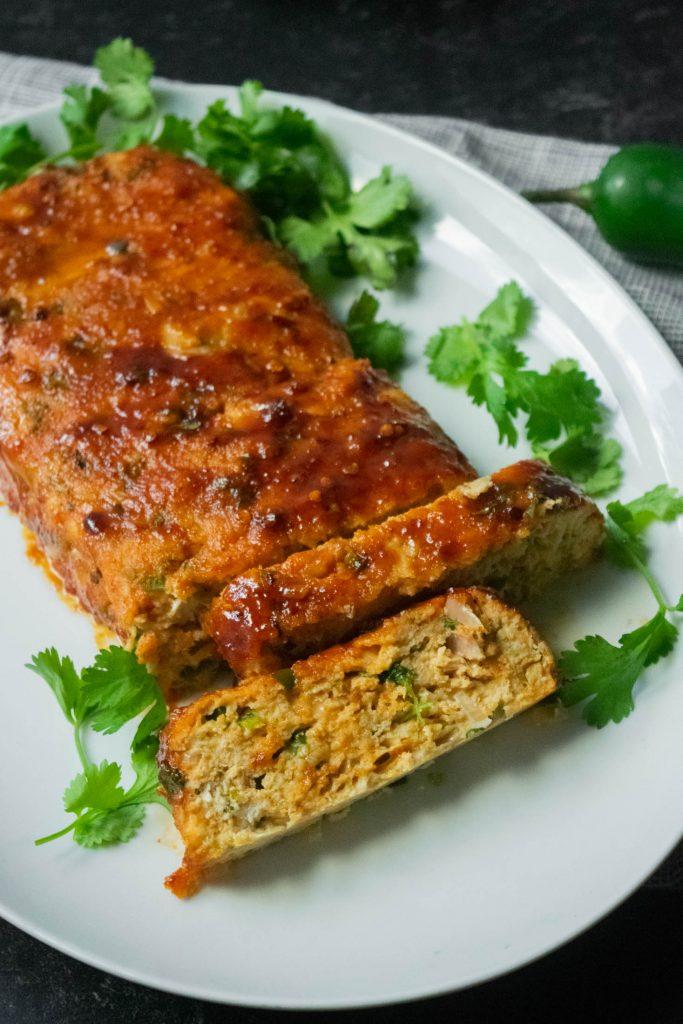 sliced chicken meatloaf with cilantro cheddar jalapeño