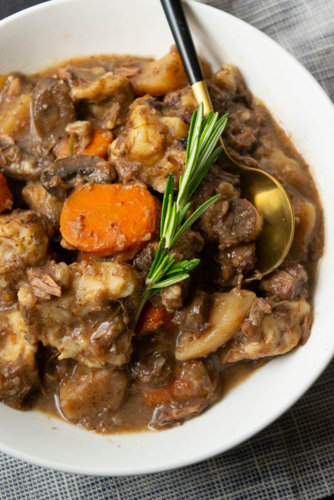 bowl of beef stew with dumplings