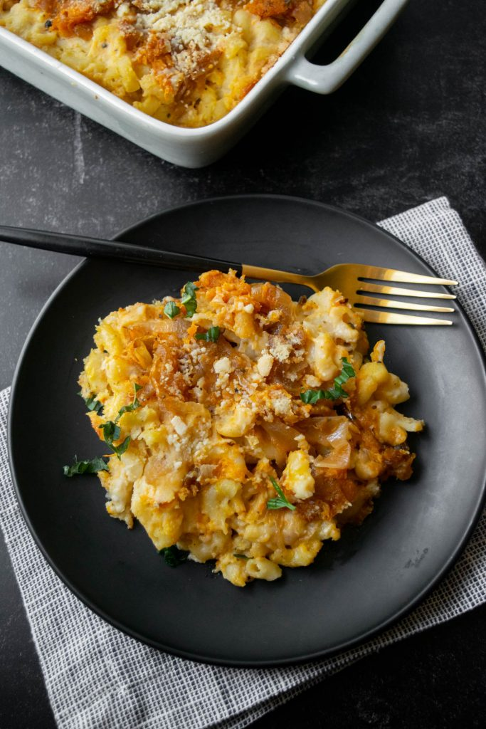plated baked butternut squash mac and cheese with basil topping