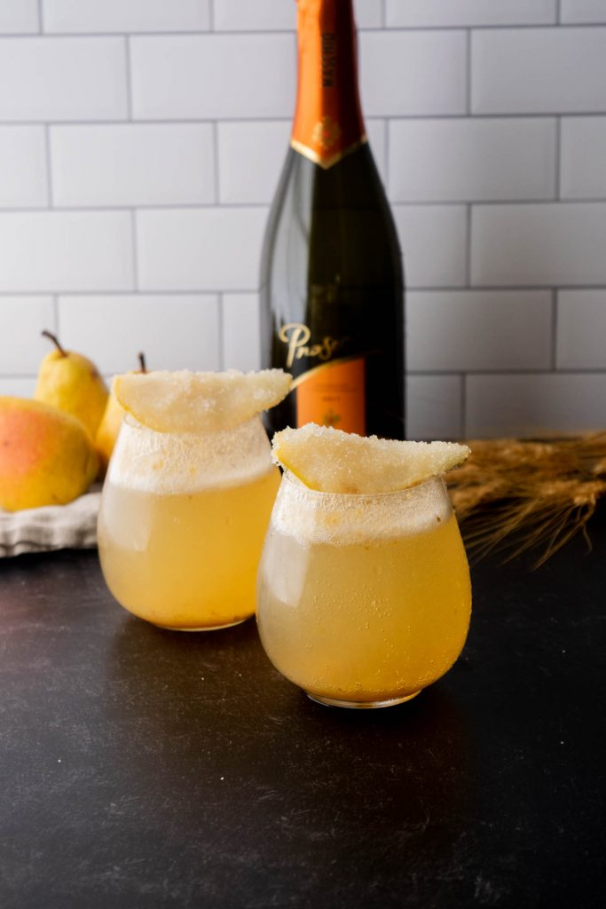 prosecco with spiced syrup and pears