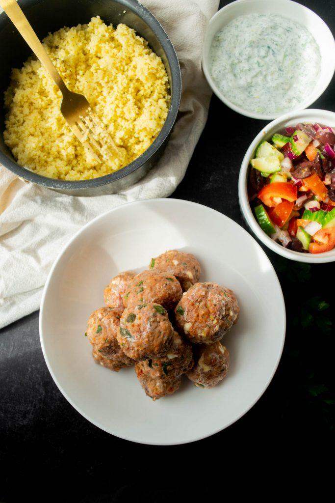 couscous, cucumber salad, tzatziki and lamb meatballs
