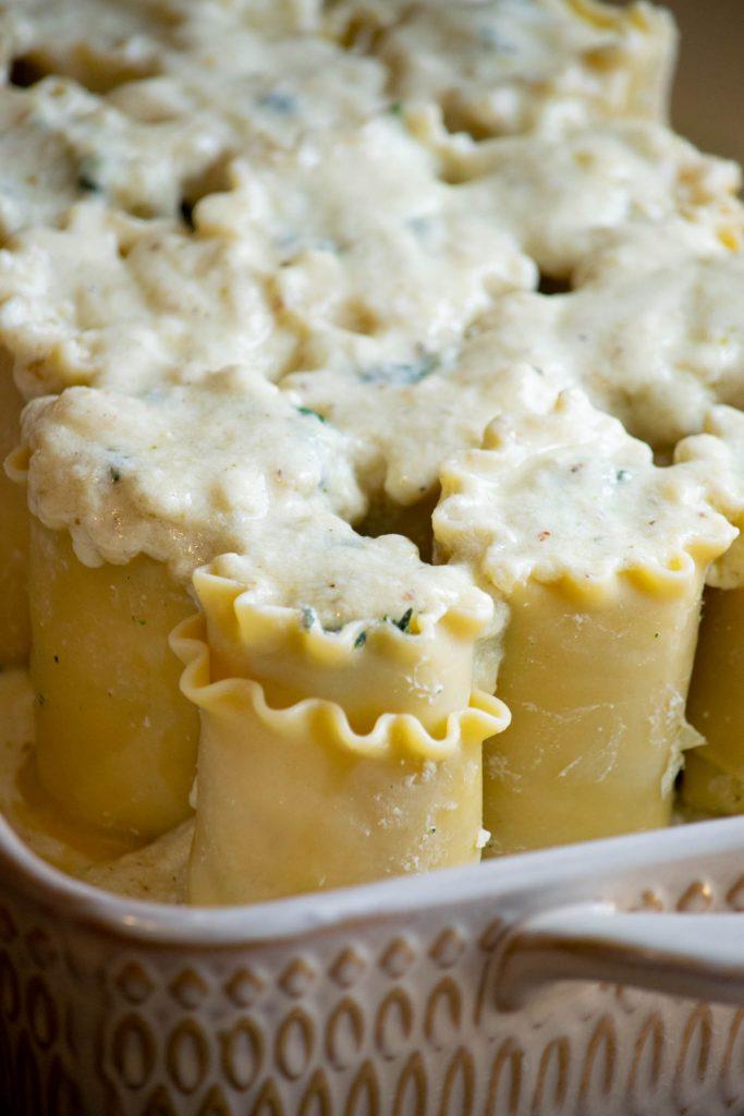 saucing the lasagna roll ups